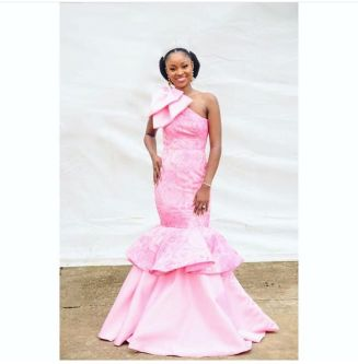 Woman wearing pink dress, made by tope