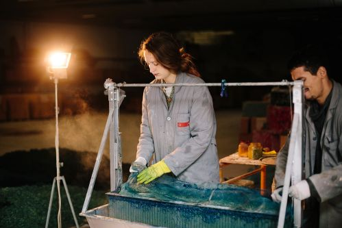 Woman working with blue material