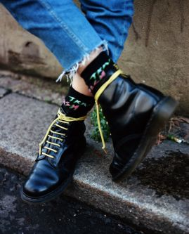 Close up shot of boots with yellow laces