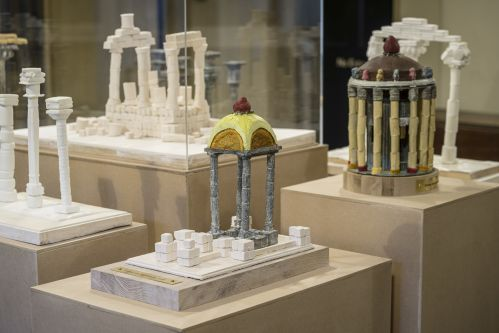 a series of sculptures presenting different reconstructions of roman column structures