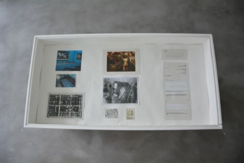 the inside of a vitrine with documents laid out in it