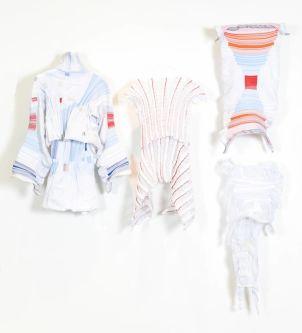 Sci-fi garments against white wall