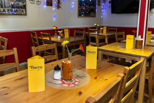 La Barra restaurant, located in one of the arches at the Eagle's Yard, displaying the new menus designed by Caley Dewhurst.