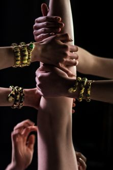 Image of models' hands and arms wearing Serpenti jewellery