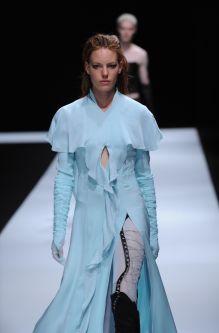 Female model wearing long blue dress designed by Katie Scotts