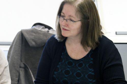 Debbie teaching in class.