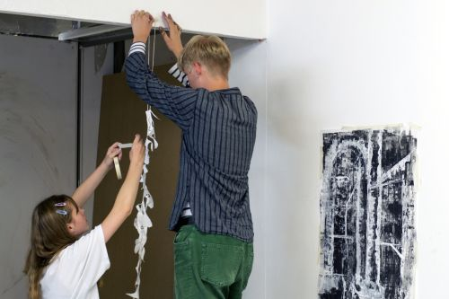 Students putting up exhibition.