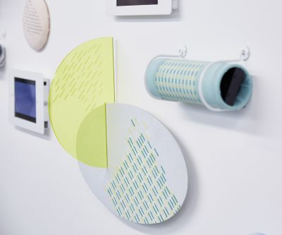 Installation featuring various textile material samples by Xiaohan Liu.