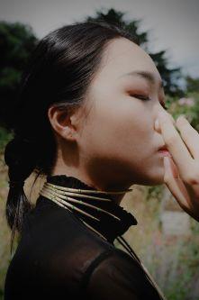 A model wearing Kirsten Schultze's Evergreen necklace