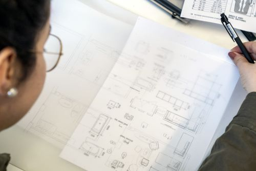 Student working on a technical drawing.
