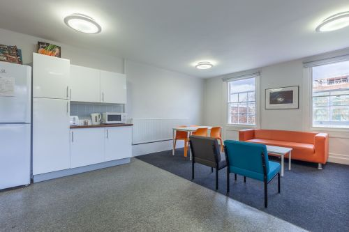 Shared kitchen with oven, sinks cupboards, hobs, microwave, fridge and seating space