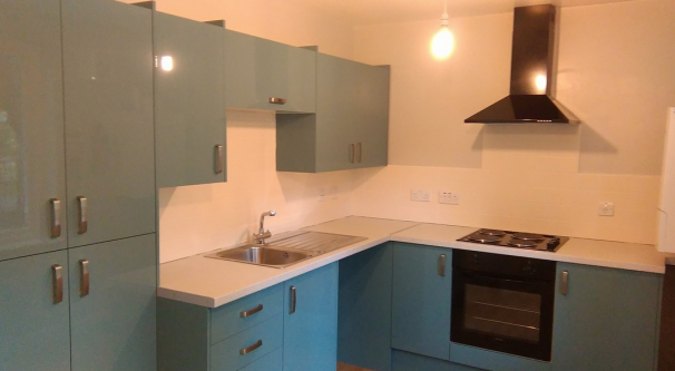 Shared kitchen painted light blue and white without students belongings inside