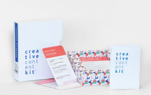 A display of various cards and designed materials in a Creative Content Kit.