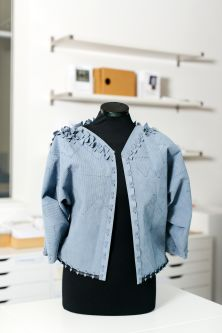 Pale blue jacket on a mannequin by Laetitia Forst.