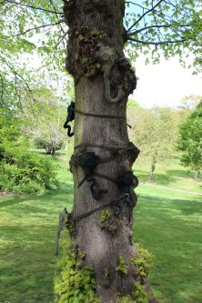 Gas masks wrapped around tree trunk