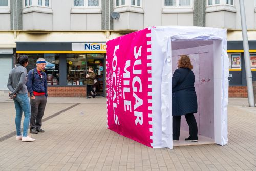 People interacting with a large installation on a high street