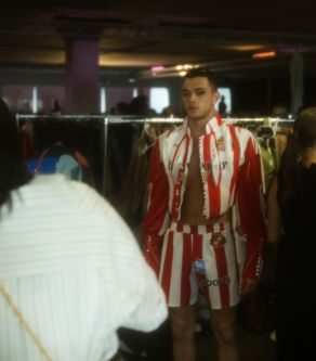 Male model in red an white outfit