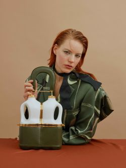 ginger lady sitting at table with bag