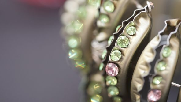 Close up of the necklaces designed by Jing Han using old bottle tops and repurposed Swarovski crystals
