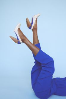 Colbalt blue trousers worn with high heels