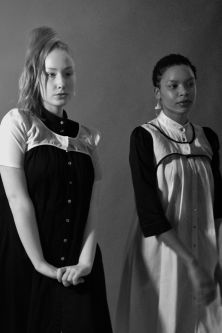 Blonde and brunette models wearing reversible black and white shirt dresses