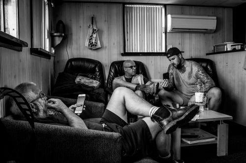 men relaxing on sofas
