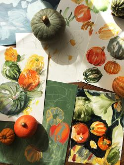 A number of illustrations of pumpkins with produce on table.