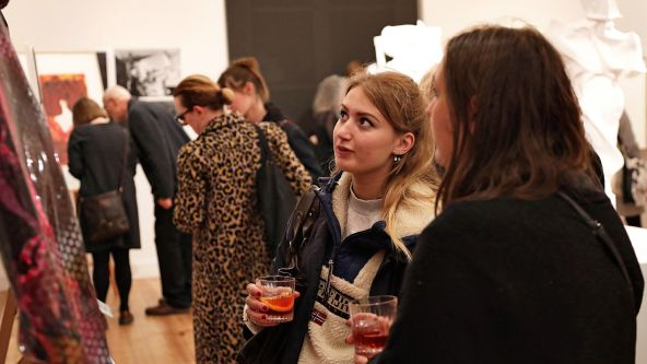 Gallery visitors viewing artwork at the Campari Creates event