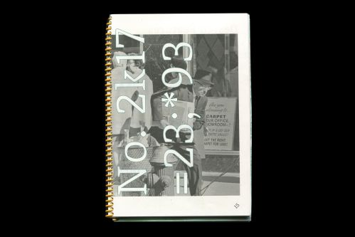 Photograph of a portfolio book, digits overlaid over image of a man on the front cover.