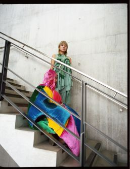 2 models sitting on the stairs at CSM, wearing creations from Study Abroad on BA Fashion
