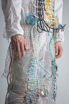model draped in mesh and wire garment
