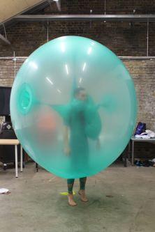 A model wearing a large turquoise baloon