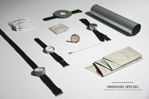 A series of watches and components laid out on a white surface