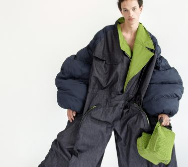 Male model in grey and lime green puffa coat