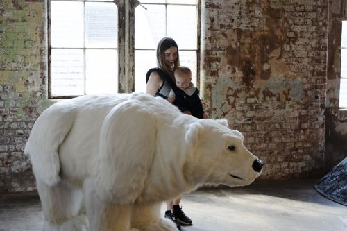 Mother and child looking at Polar Bear