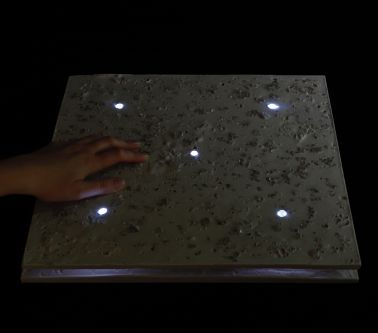 Riina Oun's Pavement powered by piezoelectricity lit up in the dark