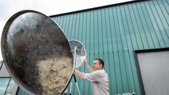 Image of Sean Ross setting up his solar furnace