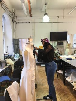 Tope designing her bodice