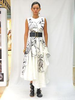 Woman wearing dress on catwalk