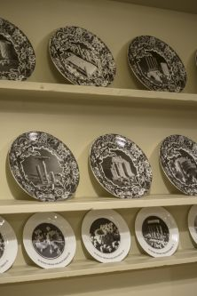 close up of illustrated plates presented on shelves