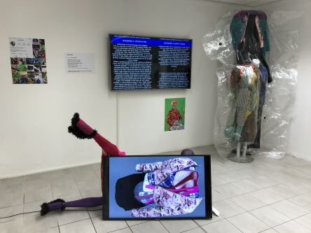 gallery installation with monitor and sculpture
