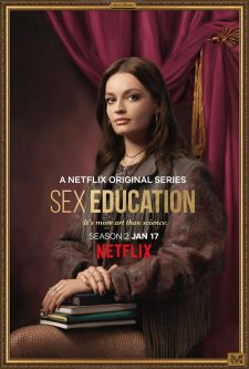 A promotional portrait of Maeve from the Netflix series, Sex Education, holding books.