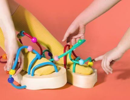 block sandles made with kids toy wiring and moveable beads
