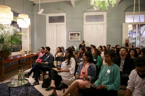 Photo of people sitting down, listening to a talk