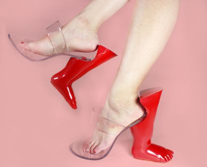 Transparent shoes with red foot shaped heels