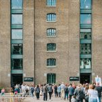 Photograph of people queuing outside the CSM building to get into the degree show