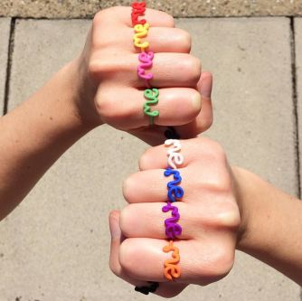 A collection of rings with the words 'me' created by artist and jewellery designer Zoe Sherwood
