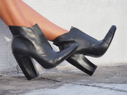 Black leather heeled boots being worn