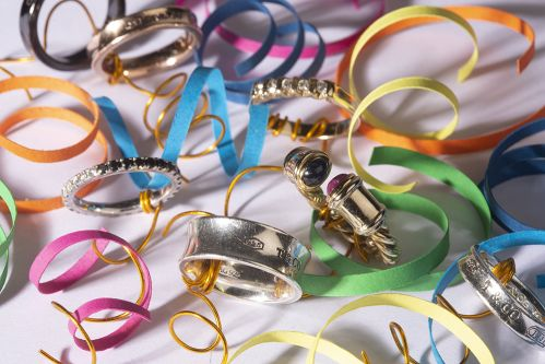 Work by Visual Merchandising - Interiors students, taken by Sarah Manning. Silver and gold rings sat among bright coloured ribbons and gold wire.
