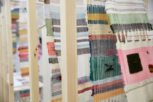 Woven textile samples displayed within wooden frames by Sara Kelly.